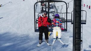 Seven Oaks Recreation ski lift with two skiers